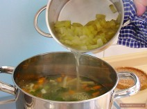 Add cooked pickled cucumbers with liquid. Check for taste. If Rassolnik is not salty enough, carefully add brine to taste.