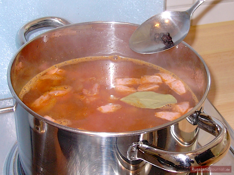 Boil the stock up, add stirred onions, cucumbers, meat, brine, peppercorns and the bay leaf and simmer for about 10 minutes.