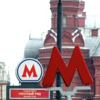 Two red Metro signs next to the Red Square in Moscow