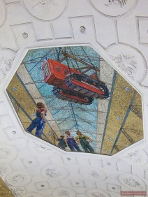 Ceiling mosaic with red tractor of Novokuznetskaya Metro Station in Moscow