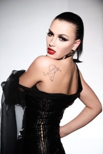 Anastasia Prikhodko wearing a black shoulder-free dress
