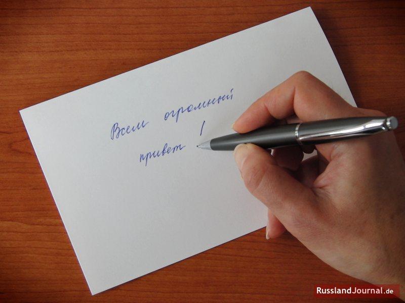 Ein riesengroßer Gruß an alle! in russischer Schreibschrift