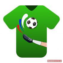 Grünes T-Shirt mit Fußball und einem kickenden Bein