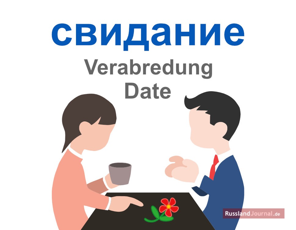 Frau und Mann an einem Tisch mit Blume
